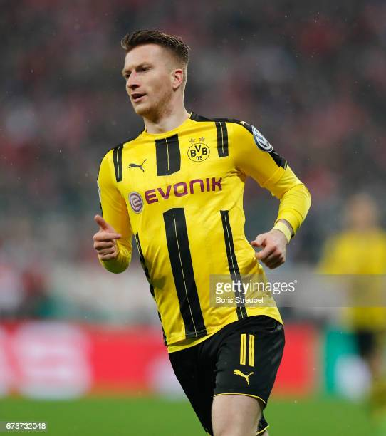 Marco Reus of Borussia Dortmund runs during the DFB Cup semi final match between FC Bayern Muenchen and Borussia Dortmund at Allianz Arena on April...