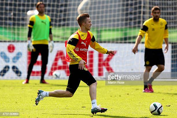 Marco Reus of Borussia Dortmund runs with the ball during the DFB Cup Final 2015 training session at Olympiastadion on May 29 2015 in Berlin Germany