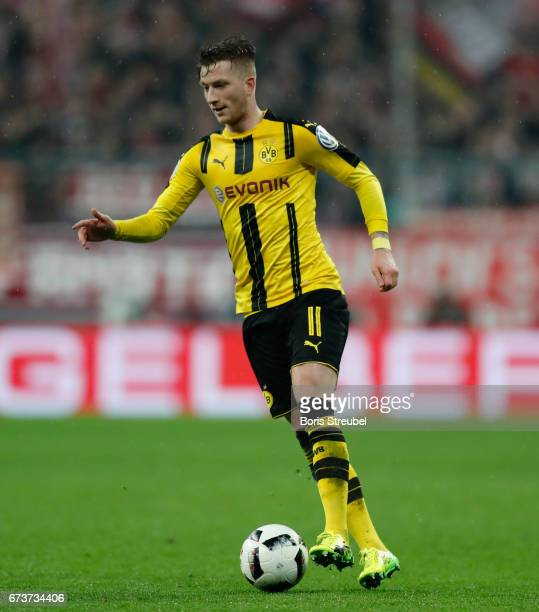 Marco Reus of Borussia Dortmund runs with the ball during the DFB Cup semi final match between FC Bayern Muenchen and Borussia Dortmund at Allianz...
