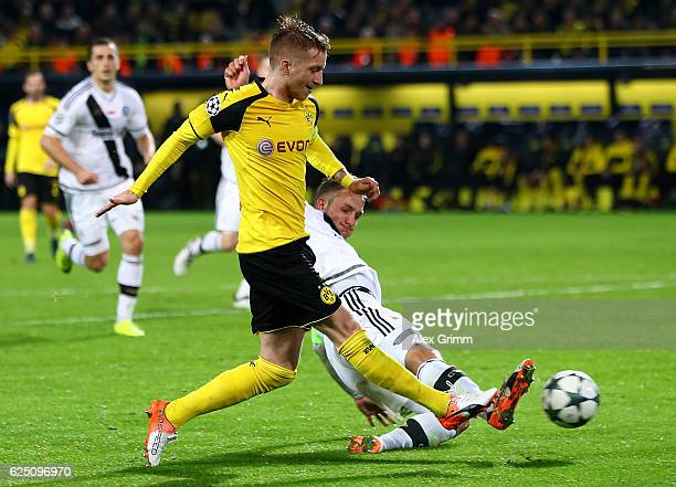 Marco Reus of Borussia Dortmund scores his third od the game and his teams eighth during the UEFA Champions League Group F match between Borussia...
