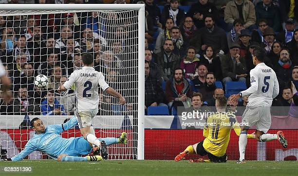 Marco Reus of Borussia Dortmund scores the equalising goal past Keylor Navas of Real Madrid during the UEFA Champions League Group F match between...
