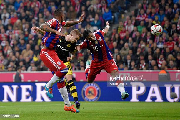 Marco Reus of Borussia Dortmund scores the first goal from a header during the Bundesliga match between FC Bayern Muenchen and Borussia Dortmund at...