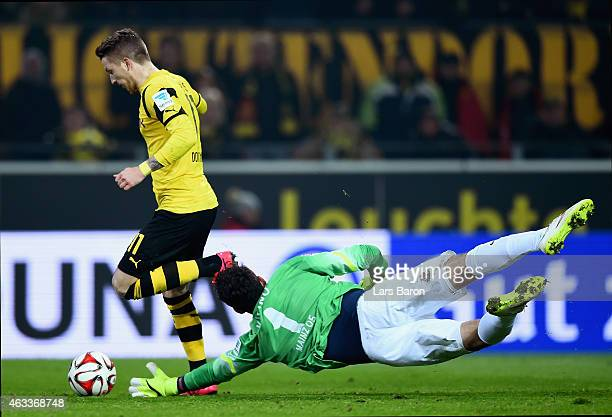 Marco Reus of Borussia Dortmund scores their second goal past goalkeeper Stefanos Kapino of 1 FSV Mainz 05 during the Bundesliga match between...