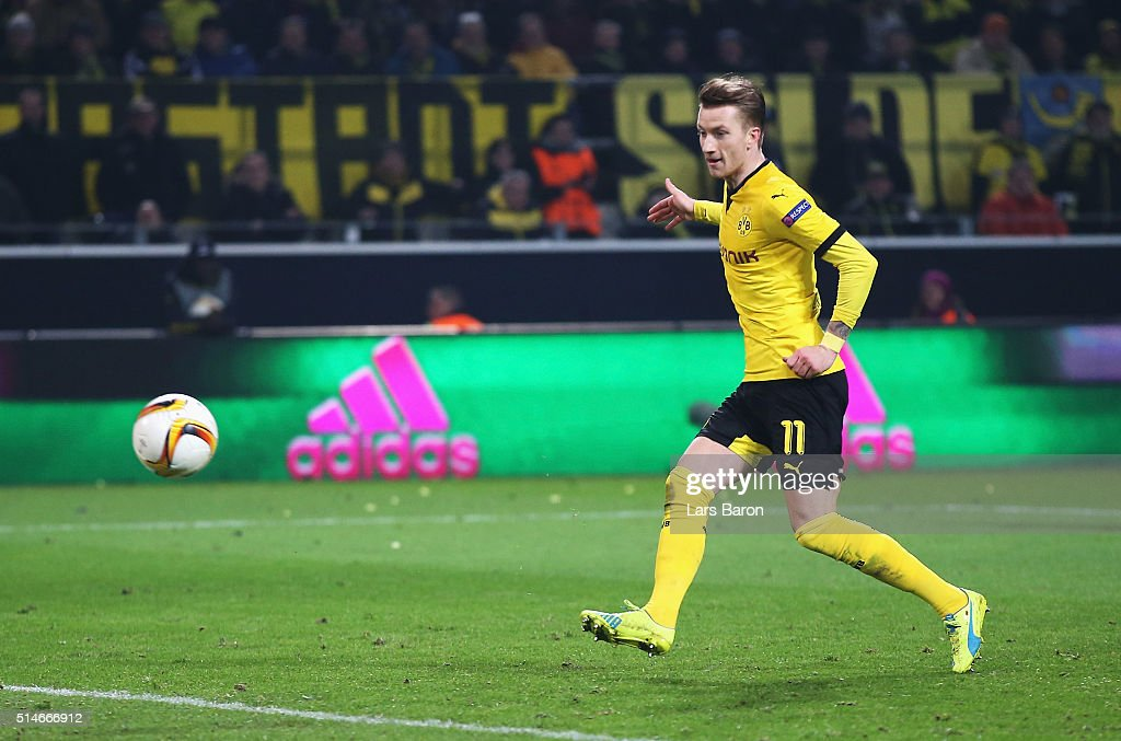 Marco Reus of Borussia Dortmund scores their third goal during the UEFA Europa League Round of 16 first leg match between Borussia Dortmund and Tottenham Hotspur at Signal Iduna Park on March 10, 2016 in Dortmund, Germany.
