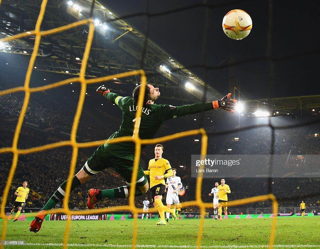 Marco Reus of Borussia Dortmund scores their third goal past goalkeeper Hugo Lloris of Tottenham Hotspur during the UEFA Europa League Round of 16 first leg match between Borussia Dortmund and Tottenham Hotspur at Signal Iduna Park on March 10, 2016 in Dortmund, Germany.