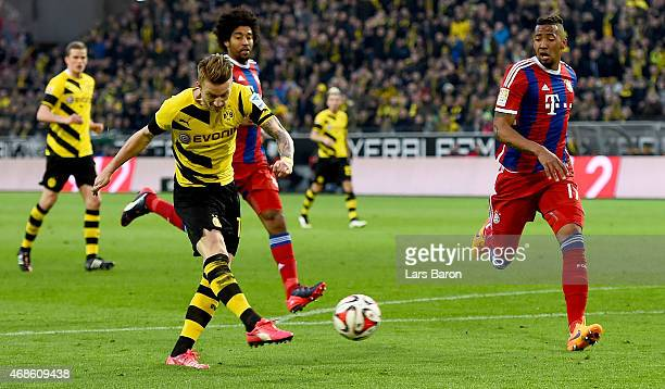 Marco Reus of Borussia Dortmund shoots on goal during the Bundesliga match between Borussia Dortmund and FC Bayern Muenchen at Signal Iduna Park on...