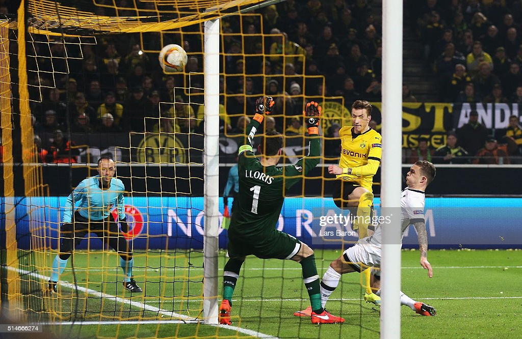 Marco Reus of Borussia Dortmund shoots past Hugo Lloris of Tottenham Hotspur to score their second goal during the UEFA Europa League Round of 16 first leg match between Borussia Dortmund and Tottenham Hotspur at Signal Iduna Park on March 10, 2016 in Dortmund, Germany.