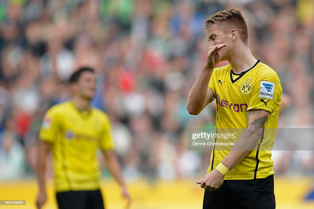 <a gi-track='captionPersonalityLinkClicked' href=/galleries/search?phrase=Marco+Reus&family=editorial&specificpeople=5445884 ng-click='$event.stopPropagation()'>Marco Reus</a> of Borussia Dortmund shows his frustration during the Bundesliga match between Borussia Moenchengladbach and Borussia Dortmund at Borussia-Park on October 5, 2013 in Moenchengladbach, Germany.