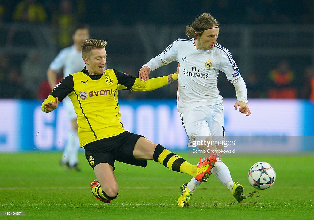 <a gi-track='captionPersonalityLinkClicked' href=/galleries/search?phrase=Marco+Reus&family=editorial&specificpeople=5445884 ng-click='$event.stopPropagation()'>Marco Reus</a> of Borussia Dortmund tackles <a gi-track='captionPersonalityLinkClicked' href=/galleries/search?phrase=Luka+Modric&family=editorial&specificpeople=560350 ng-click='$event.stopPropagation()'>Luka Modric</a> of Real Madrid during the UEFA Champions League Quarter Final second leg match between Borussia Dortmund and Real Madrid at Signal Iduna Park on April 8, 2014 in Dortmund, Germany.