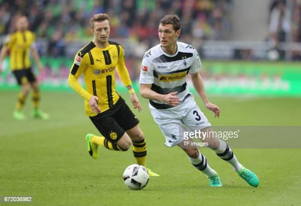 Marco Reus of Dortmund and Andreas Christensen of Moenchengladbach battle for the ball during the Bundesliga match between Borussia Moenchengladbach...