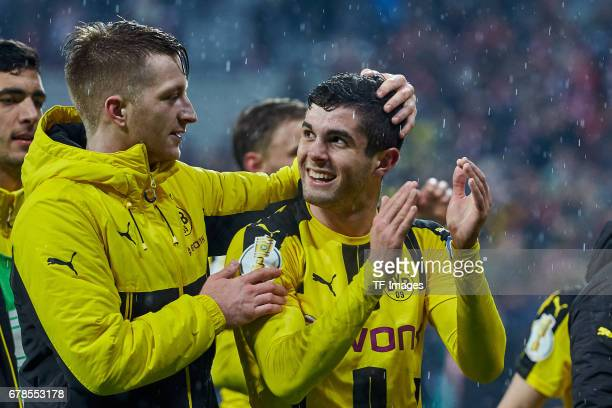 Marco Reus of Dortmund and Christian Pulisic of Dortmund celebrates the win after the final whistle during the German Cup semi final soccer match...