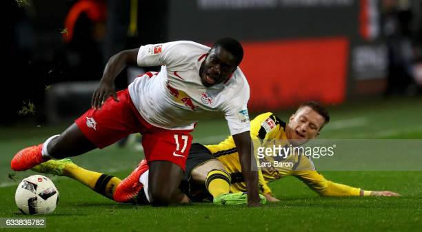 Marco Reus of Dortmund and Dayot Upamecano of Leipzig battle for the ball during the Bundesliga match between Borussia Dortmund and RB Leipzig at...
