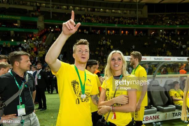 Marco Reus of Dortmund and his girlfriend Scarlett Gartmann looks on during the DFB Cup final match between Eintracht Frankfurt and Borussia Dortmund...