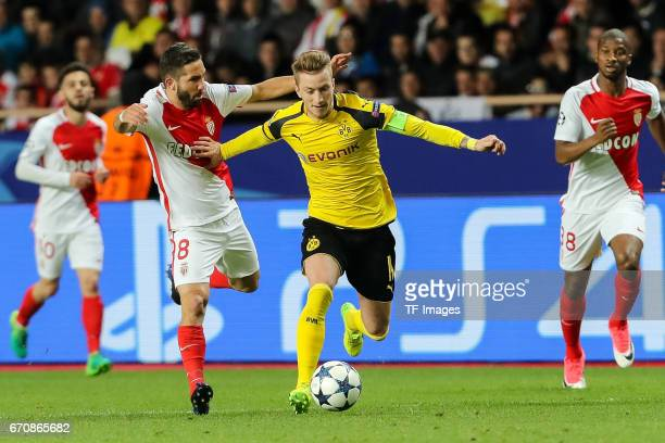 Marco Reus of Dortmund and Joao Moutinho of Monaco battle for the ball during the UEFA Champions League quarter final second leg match between AS...