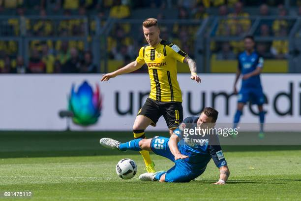Marco Reus of Dortmund and Niklas Suele of Hoffenheim battle for the ball during the Bundesliga match between Borussia Dortmund and TSG 1899...