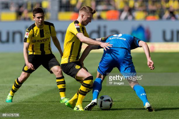 Marco Reus of Dortmund and Pavel Kaderabek battle for the ball during the Bundesliga match between Borussia Dortmund and TSG 1899 Hoffenheim at...