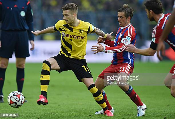 Marco Reus of Dortmund and Philipp Lahm of Muenchen compete for the ball during the Bundesliga match between Borussia Dortmund and FC Bayern Muenchen...