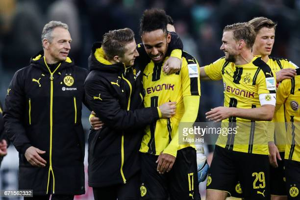 Marco Reus of Dortmund and PierreEmerick Aubameyang celebrate after the Bundesliga match between Borussia Moenchengladbach and Borussia Dortmund at...