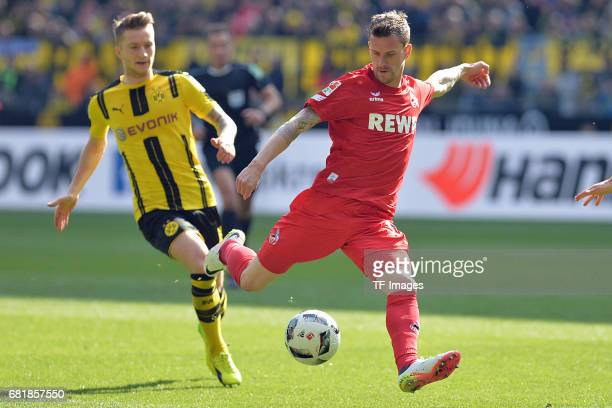 Marco Reus of Dortmund and Simon Zoller of Colonge battle for the ball during the Bundesliga match between Borussia Dortmund and FC Koeln at Signal...