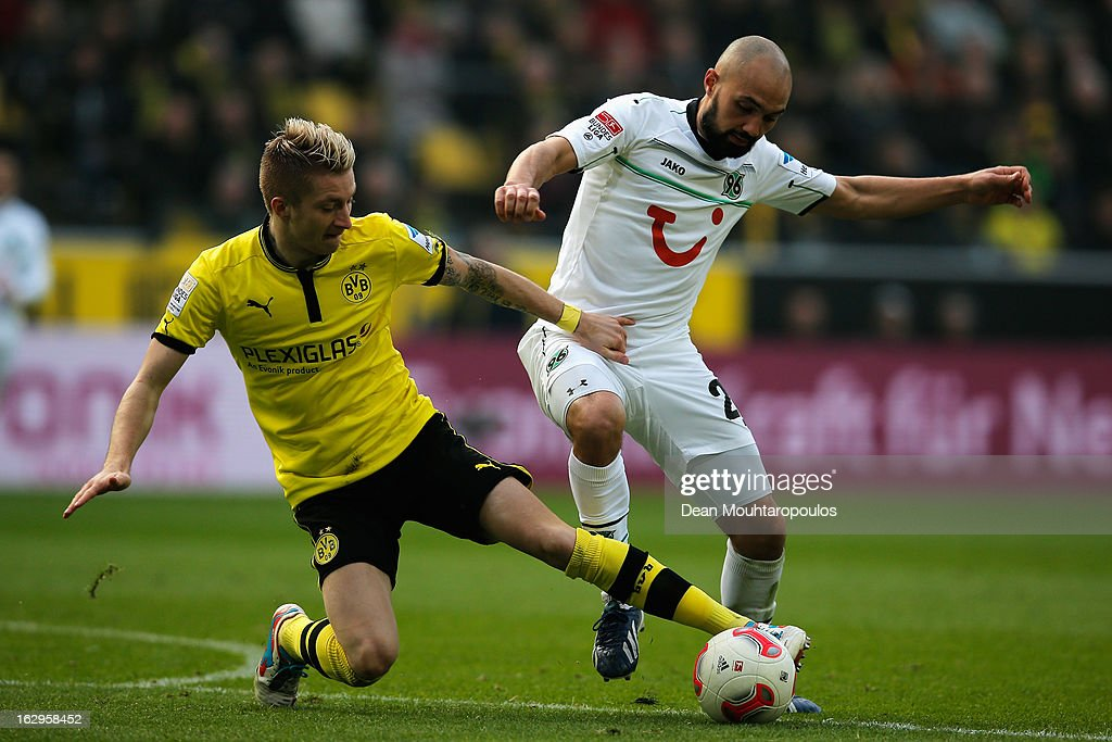 Marco Reus of Dortmund and Sofian Chahed of Hannover battle for the ball during the Bundesliga match between Borussia Dortmund and Hannover 96 at...