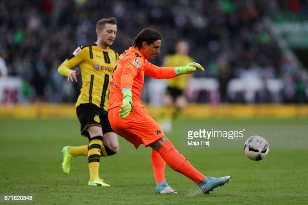Marco Reus of Dortmund and Yann Sommer goalkeeper of Moenchengladbach battle for the ball during the Bundesliga match between Borussia...