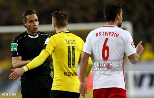 Marco Reus of Dortmund argues with referee Tobias Stieler during the Bundesliga match between Borussia Dortmund and RB Leipzig at Signal Iduna Park...
