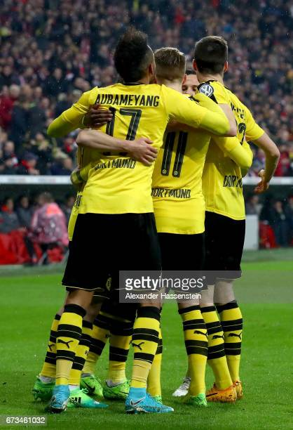 Marco Reus of Dortmund celebrate with his team mates after he scores the opening goal during the DFB Cup semi final match between FC Bayern Muenchen...