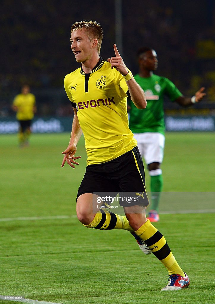 <a gi-track='captionPersonalityLinkClicked' href=/galleries/search?phrase=Marco+Reus&family=editorial&specificpeople=5445884 ng-click='$event.stopPropagation()'>Marco Reus</a> of Dortmund celebrates after scoring his teams first goal during the Bundesliga match between Borussia Dortmund and Werder Bremen at Signal Iduna Park on August 24, 2012 in Dortmund, Germany.