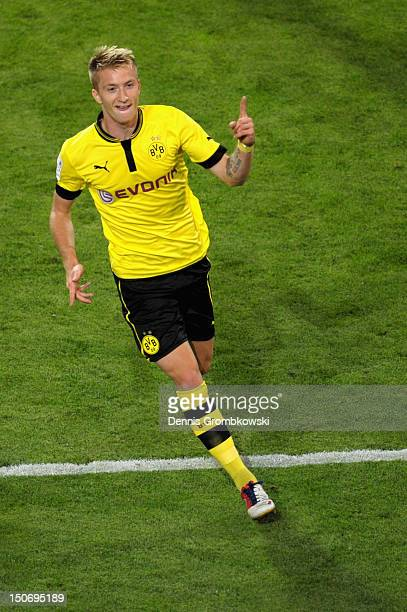 Marco Reus of Dortmund celebrates after scoring his team's first goal during the Bundesliga match between Borussia Dortmund and Werder Bremen at...