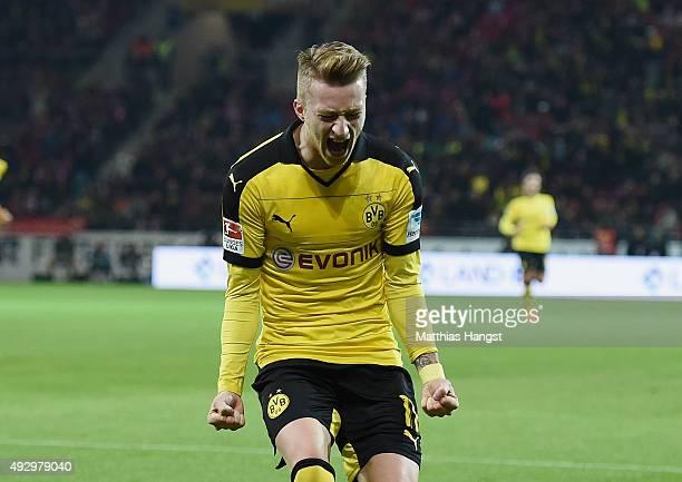 Marco Reus of Dortmund celebrates after scoring his team's first goal during the Bundesliga match between 1 FSV Mainz 05 and Borussia Dortmund at...