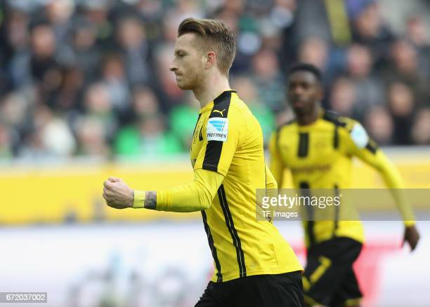 Marco Reus of Dortmund celebrates after scoring his teams first goal during the Bundesliga match between Borussia Moenchengladbach and Borussia...