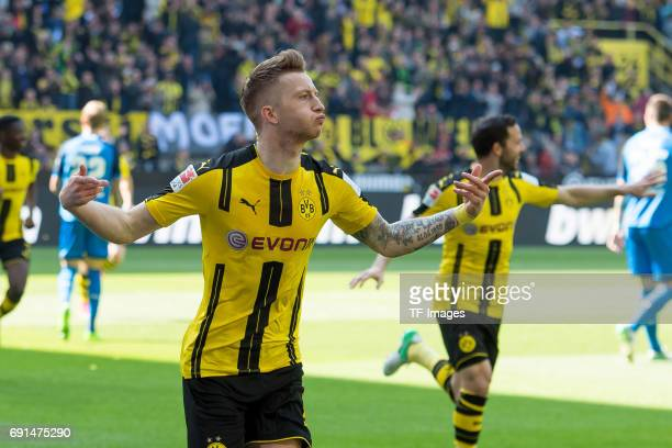 Marco Reus of Dortmund celebrates after scoring his team`s first goal during the Bundesliga match between Borussia Dortmund and TSG 1899 Hoffenheim...