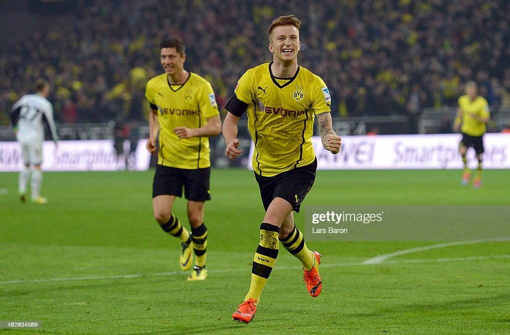 <a gi-track='captionPersonalityLinkClicked' href=/galleries/search?phrase=Marco+Reus&family=editorial&specificpeople=5445884 ng-click='$event.stopPropagation()'>Marco Reus</a> of Dortmund celebrates after scoring his teams second goal during the Bundesliga match between Borussia Dortmund and VfL Wolfsburg at Signal Iduna Park on April 5, 2014 in Dortmund, Germany.