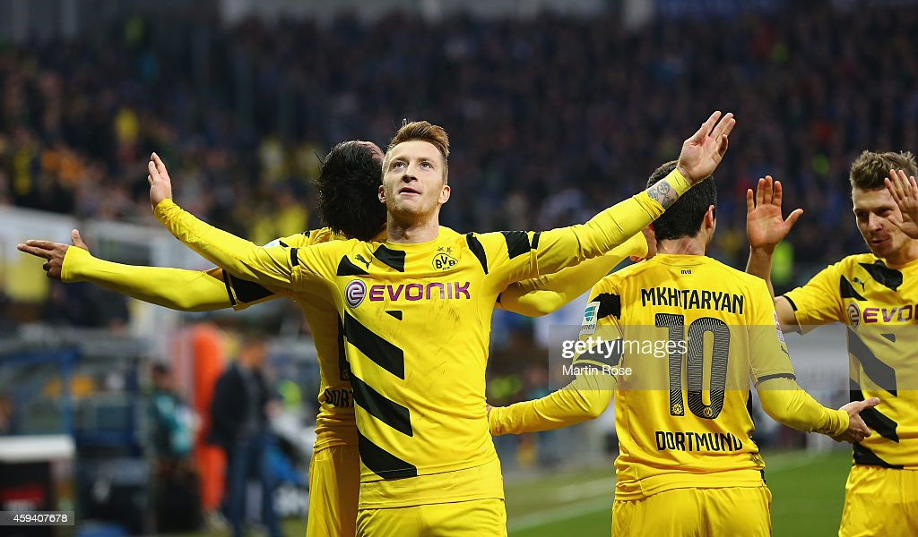 <a gi-track='captionPersonalityLinkClicked' href=/galleries/search?phrase=Marco+Reus&family=editorial&specificpeople=5445884 ng-click='$event.stopPropagation()'>Marco Reus</a> of Dortmund celebrates after scoring the 2nd goal during the Bundesliga match between SC Paderborn and Borussia Dortmund at Benteler Arena on November 22, 2014 in Paderborn, Germany.