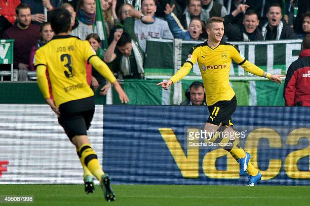 Marco Reus of Dortmund celebrates after scoring the opening goal during the Bundesliga match between Werder Bremen and Borussia Dortmund at...