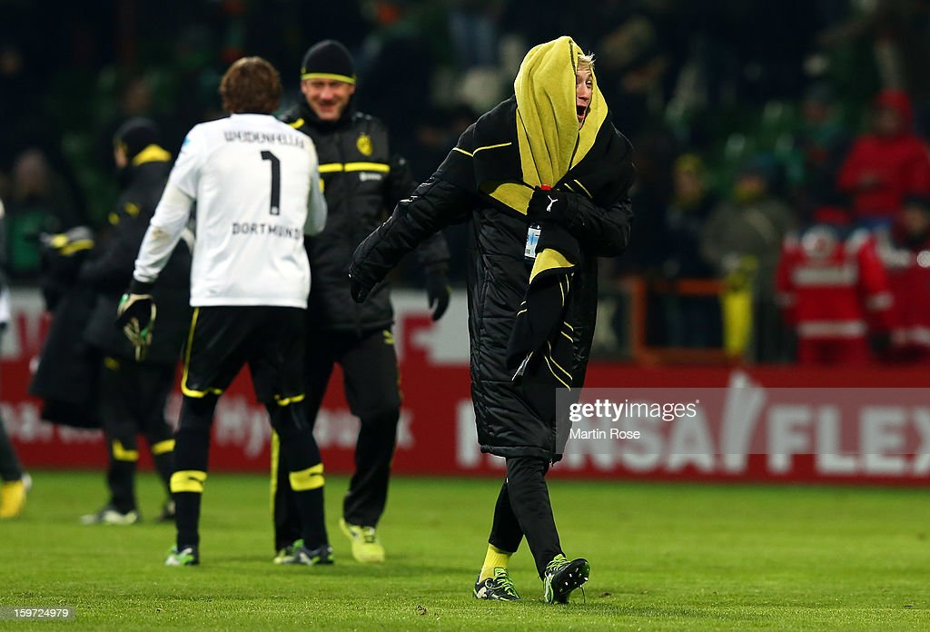 <a gi-track='captionPersonalityLinkClicked' href=/galleries/search?phrase=Marco+Reus&family=editorial&specificpeople=5445884 ng-click='$event.stopPropagation()'>Marco Reus</a> of Dortmund celebrates after the Bundesliga match between Werder Bremen and Borussia Dortmund at Weser Stadium on January 19, 2013 in Bremen, Germany.