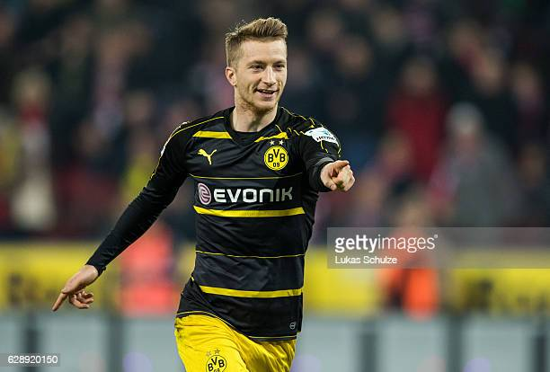 Marco Reus of Dortmund celebrates his goal during the Bundesliga match between 1 FC Koeln and Borussia Dortmund at RheinEnergieStadion on December 10...
