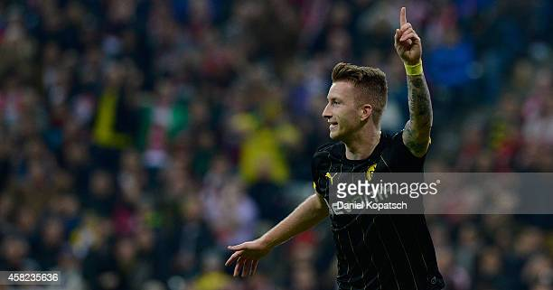 Marco Reus of Dortmund celebrates his team's first goal during the Bundesliga match between FC Bayern Muenchen and Borussia Dortmund at Allianz Arena...