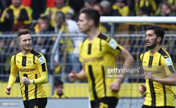 Marco Reus of Dortmund celebrates his team's first goal with team mates during the Bundesliga match between Borussia Dortmund and Eintracht Frankfurt...