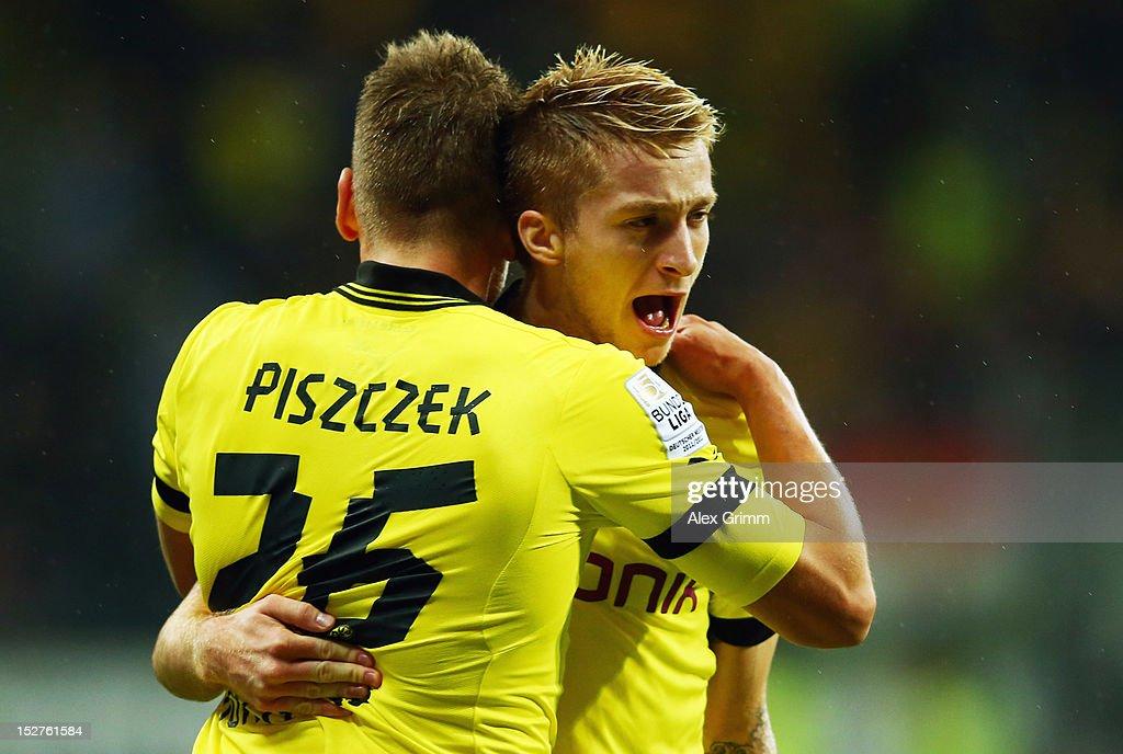 Marco Reus of Dortmund celebrates his team's second goal with team mate Lukasz Piszczek during the Bundesliga match between Eintracht Frankfurt and...