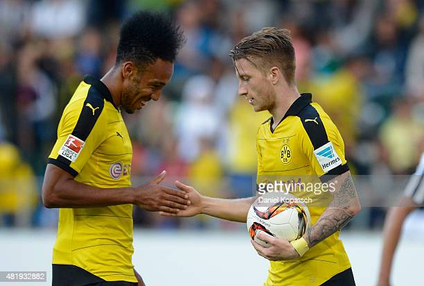 Marco Reus of Dortmund celebrates his team's second goal with team mate PierreEmerick Aubameyang during the friendly match between Juventus and...