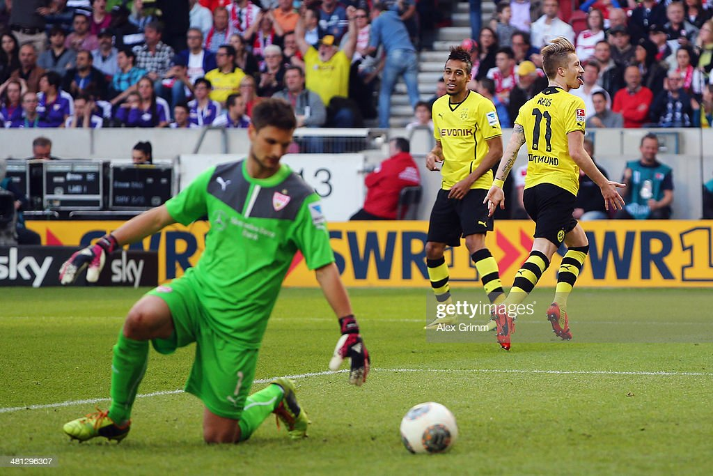 <a gi-track='captionPersonalityLinkClicked' href=/galleries/search?phrase=Marco+Reus&family=editorial&specificpeople=5445884 ng-click='$event.stopPropagation()'>Marco Reus</a> #11 of Dortmund celebrates his team's third goal with team mate <a gi-track='captionPersonalityLinkClicked' href=/galleries/search?phrase=Pierre-Emerick+Aubameyang&family=editorial&specificpeople=6344916 ng-click='$event.stopPropagation()'>Pierre-Emerick Aubameyang</a> as goalkeeper <a gi-track='captionPersonalityLinkClicked' href=/galleries/search?phrase=Sven+Ulreich&family=editorial&specificpeople=4877030 ng-click='$event.stopPropagation()'>Sven Ulreich</a> of Stuttgart reacts during the Bundesliga match between VfB Stuttgart and Borussia Dortmund at Mercedes-Benz Arena on March 29, 2014 in Stuttgart, Germany.
