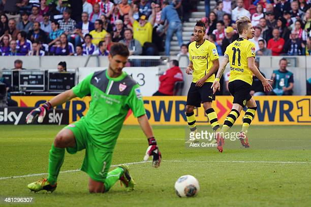 Marco Reus of Dortmund celebrates his team's third goal with team mate PierreEmerick Aubameyang as goalkeeper Sven Ulreich of Stuttgart reacts during...