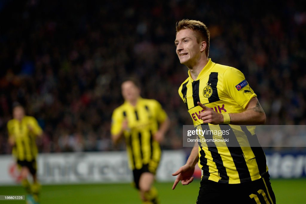 Marco Reus of Dortmund celebrates scoring his team's first goal during the UEFA Champions League Group D match between Ajax Amsterdam and Borussia Dortmund at Amsterdam Arena on November 21, 2012 in Amsterdam, Netherlands.