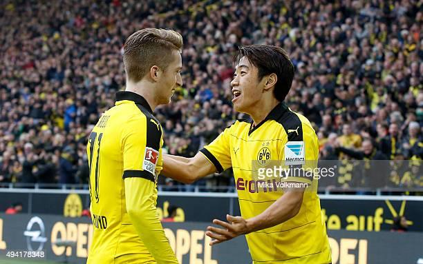 Marco Reus of Dortmund celebrates scoring the 20 goal with Shinji Kagawa of Dortmundduring the Bundesliga match between Borussia Dortmund and FC...