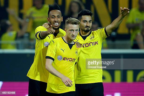 Marco Reus of Dortmund celebrates the first goal with PierreEmerick Aubameyang and Ilkay Guendogan of Dortmund during the UEFA Europa League third...