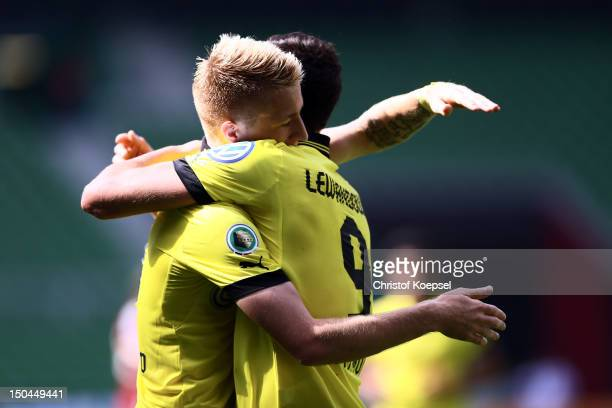 Marco Reus of Dortmund celebrates the first goal with Robert Lewandowski of Dortmund during the first round DFB Cup match between FC Oberneuland and...