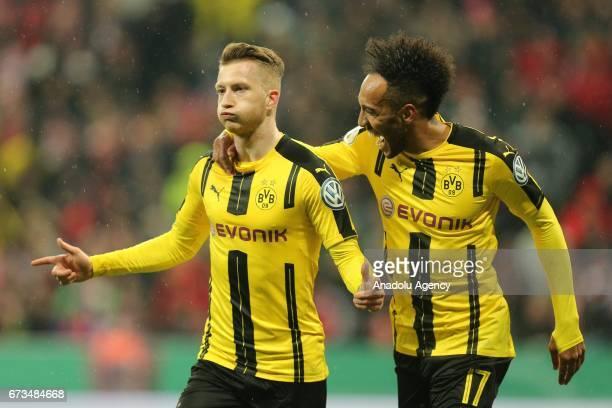 Marco Reus of Dortmund celebrates with PierreEmerick Aubameyang after scoring a goal during the German Cup semi final soccer match between FC Bayern...