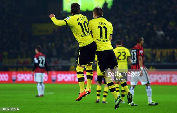 Marco Reus of Dortmund celebrates with team mate Mario Goetze after scoring his teams first goal scores his teams first goal during the Bundesliga...