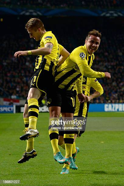 Marco Reus of Dortmund celebrates with teammate Mario Goetze after scoring his team's first goal during the UEFA Champions League Group D match...